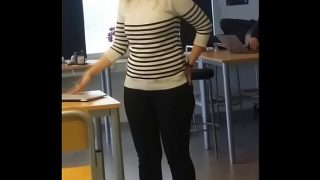 candid teacher is aware of the camera
