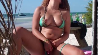 Hispanic outdoors at the beach using vibrator